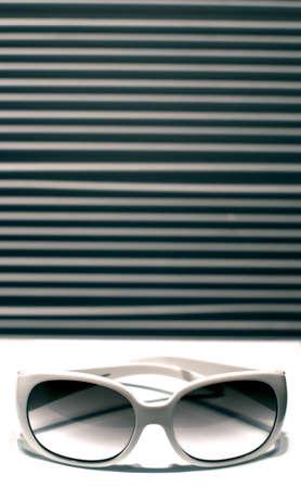 white sunglass on stripe background Stock Photo