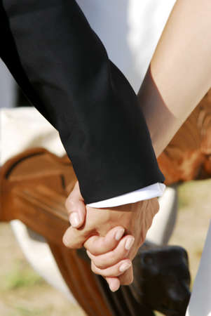 holding hands in a marriage
