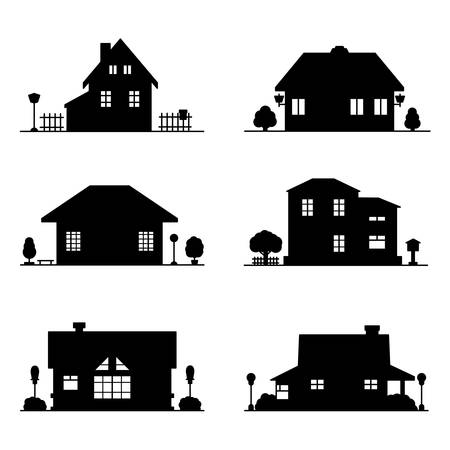 set of black silhouettes of houses on a white background 向量圖像