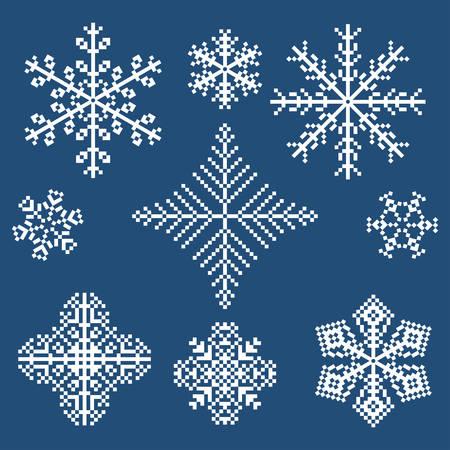 set of white pixel snowflakes on blue background 向量圖像