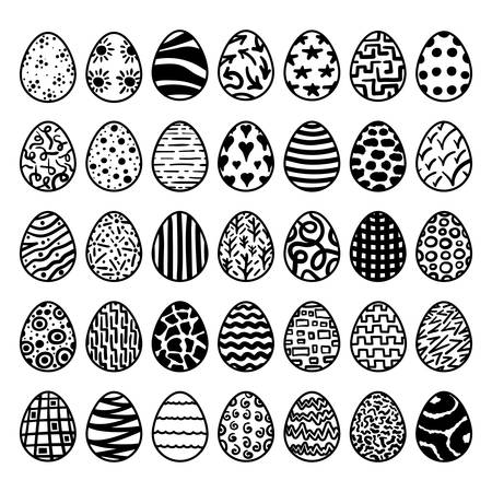set of black Easter eggs with different patterns on white background