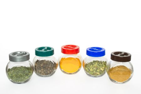 Jars with various exotic spices (fenugreek,allspice tree, turmeric, cardamom, curry) isolated on white background Stock Photo - 983471