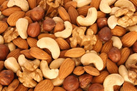 Assorted nuts (almonds, filberts, walnuts, cashews) close up Stock Photo - 983472