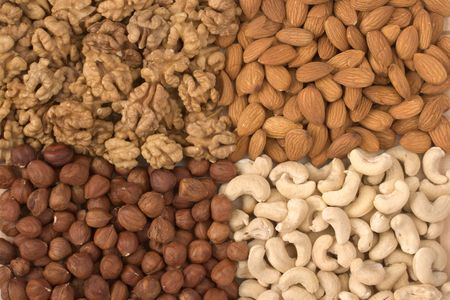 protien: Different nuts close up (almonds, walnuts, cashews, filberts) Stock Photo