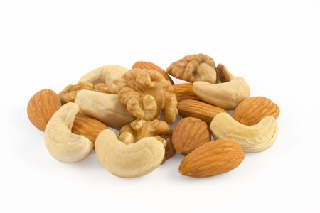 Pile of assorted nuts close up isolated on white background Stock Photo - 1357129