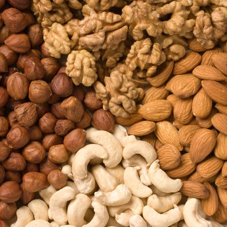 Different  nuts (almons, cashews, walnuts and filbers) close up photo