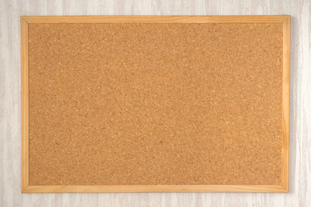 Empty cork board on the wall photo