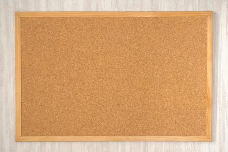 Empty cork board on the wall photo