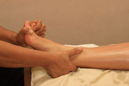 stimulate: Foot massage in spa Stock Photo