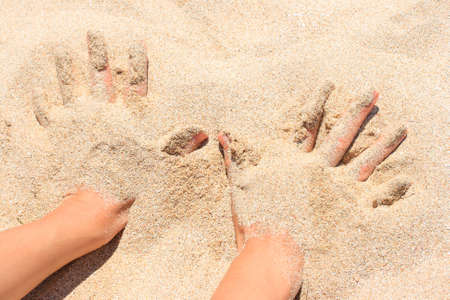 bury: Hands buried in sand