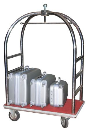 reception hotel: Three similiar suitcases on hotel baggage cart isolated on white background Stock Photo