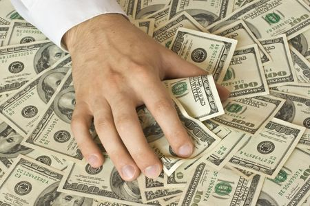 stingy: Greedy hand grabs money lot of dollars Stock Photo