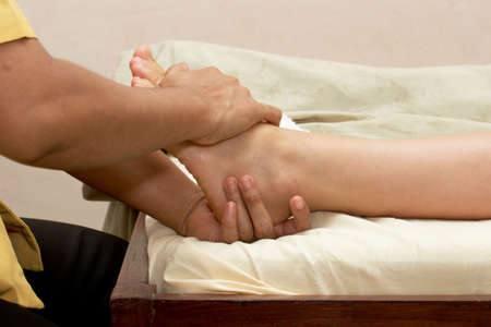 Spa foot massage close up photo