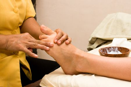 Foot stone massage in spa photo