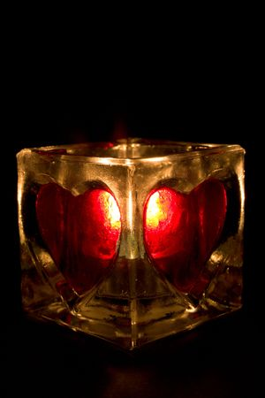 sconce: Burning candle in a sconce with hearts Stock Photo