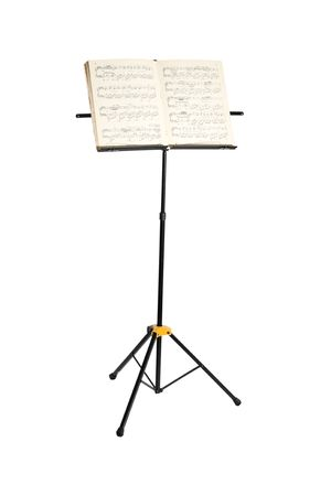 Music stand with piano notes isolated on white background Stock Photo