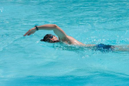 Swimming young man (the crawl) Stock Photo