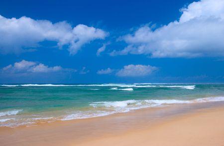 Peaceful beach scene with ocean and blue sky Stock Photo - 2982544