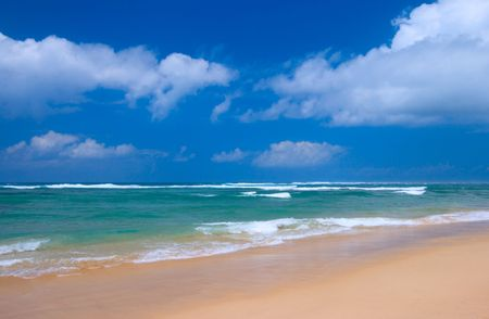 tranquil scene: Peaceful beach scene with ocean and blue sky Stock Photo