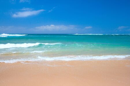 beach scene: Peaceful beach scene with ocean and blue sky Stock Photo
