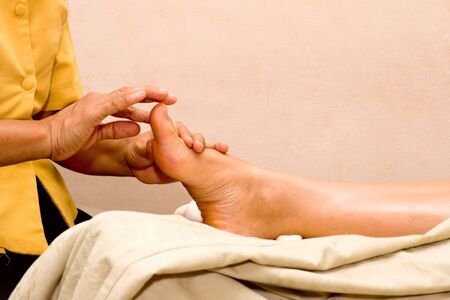 Foot massage in spa close up photo