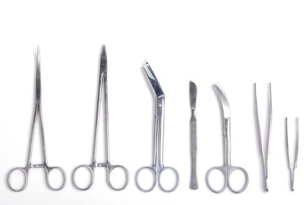 clamps: Surgeon tools - scalpel, forceps, clamps, scissors - isolated on white background Stock Photo