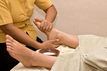 Foot massage in spa photo