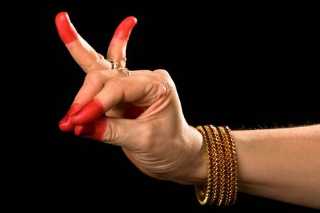 Woman hand showing Katakamukha hasta (meaning Opening in a Bracelet) of indian classic dance Bharata Natyam