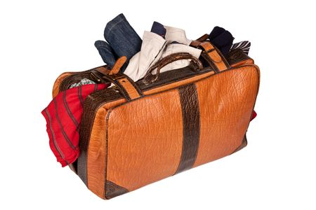 open suitcase: Overstuffed baggage in old suitcase isolated on white background Stock Photo