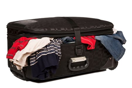 Overstuffed baggage in old suitcase isolated on white background Stock Photo