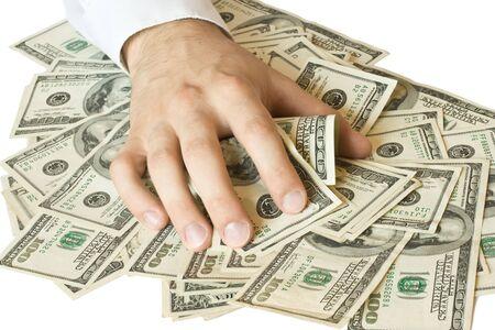 avid: Greedy hand grabs money lot of dollars Stock Photo