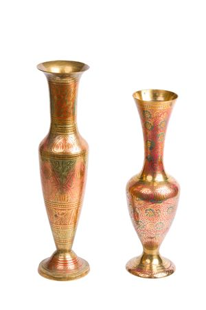 Two stamped brass vases isolated on white background photo