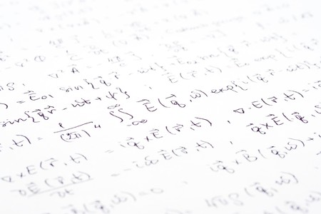 scribe: Physical equations (electromagnetics) hand written on paper Stock Photo