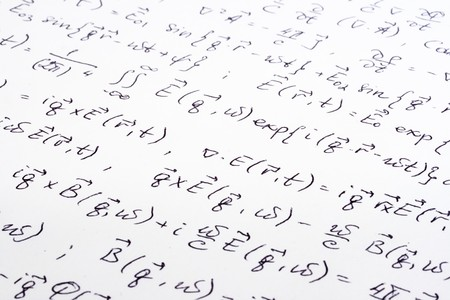 equations: Physical equations (electromagnetics) hand written on paper Stock Photo