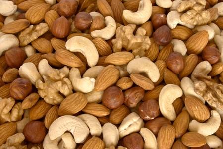 cashews: Assorted nuts (almonds, filberts, walnuts, cashews) close up