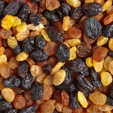 Mixed raisins of different colors close up photo