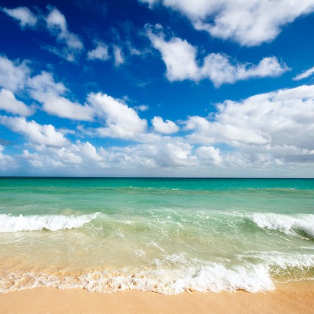 Beautiful beach and  waves of Caribbean Sea photo