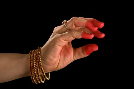 bharatanatyam dance: Woman hand showing Samdamsha hasta (hand gesture, also called mudra) (meaning generosity) of indian classic dance Bharata Natyam. Also used in other indian classical dances Kuchipudi and Odissi.