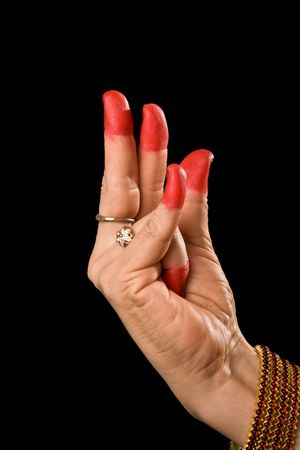 bharatanatyam dance: Woman hand showing Kangula hasta (hand gesture, also called mudra)  (meaning Tail) of indian classic dance Bharata Natyam. Also used in other indian classical dances Kuchipudi and Odissi.