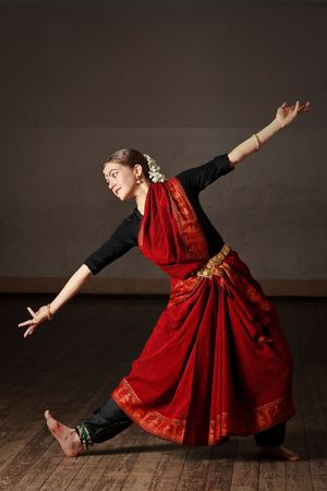 indian classical dance: Young woman in sary dancing classical traditional indian dance Bharat Natyam