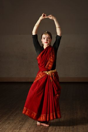 bharatanatyam dance: Young woman in sary dancing classical traditional indian dance Bharat Natyam