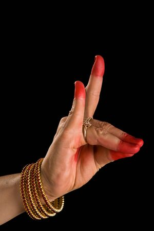 kuchipudi: Woman hand showing Simhamukha hasta  (hand gesture, also called mudra)(meaning Lion face) of indian classic dance Bharata Natyam. Also used in Indian dances Odissi and Kuchipudi.