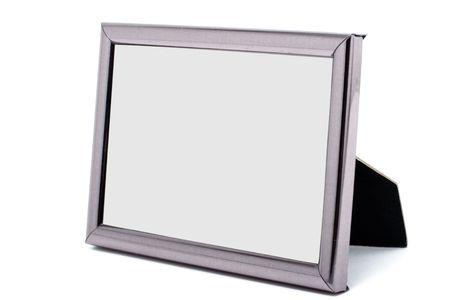 Empty metal picture frame isolated on white background photo