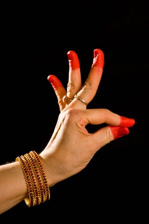 bharatanatyam dance: Woman hand showing Hamsasyo hasta  (hand gesture, also called mudra) (meaning Swan beak) of indian classic dance Bharata Natyam. Also used in other indian classical dances Kuchipudi and Odissi.