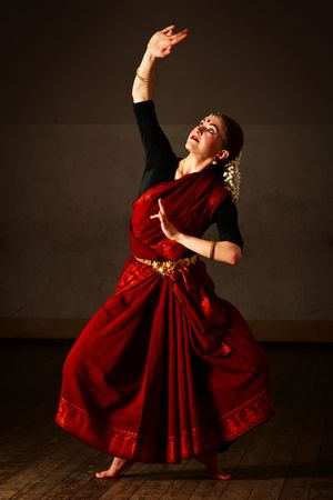 Young woman in sary dancing classical traditional indian dance Bharat Natyam photo