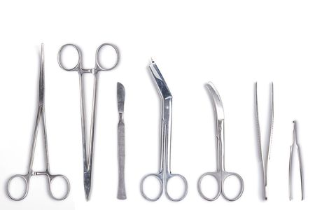 Surgeon tools - scalpel, forceps, clamps, scissors - isolated on white background photo