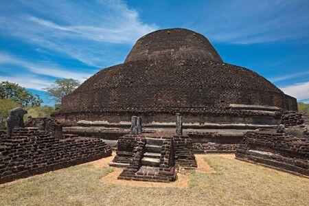 dagoba: Ancient Buddhist dagoba (stupe) Pabula Vihara. Ancient city of Pollonaruwa, Sri Lanka Stock Photo