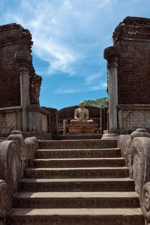 Ancient sitting Buddha image in votadage. Pollonaruwa, Sri Lanka photo