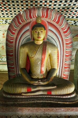 Ancient Buddha image in Dambulla Rock Temple caves, Sri Lanka photo