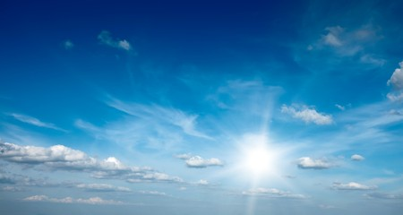 sunrays: Sun with clouds in blue sky